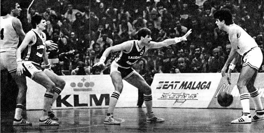 С мячом Дражен Петрович. Ему преграждают путь Гинтарас Крапикас (9) и Сергеюс Йовайша