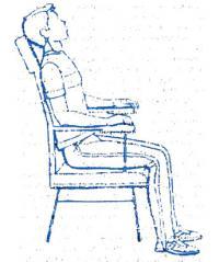 Второе положение — в кресле с подголовником и подлокотниками